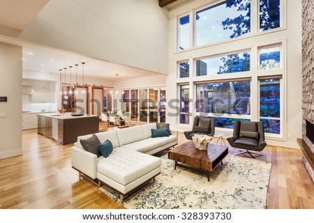 Beautiful living room with hardwood floors, fireplace and couch in new luxury home