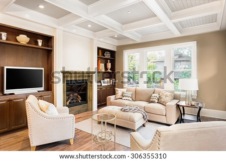 Beautiful living room with hardwood floors in new luxury home - stock photo