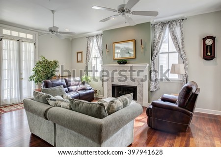 Beautiful livingroom with fireplace and furniture - stock photo