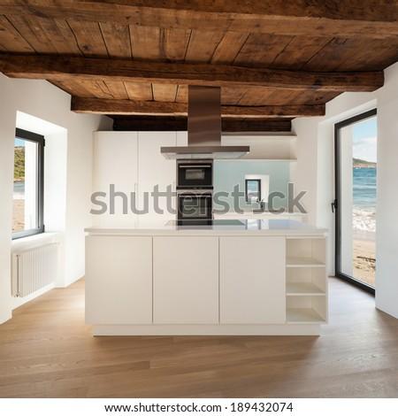 beautiful  loft, view domestic kitchen, modern furniture - stock photo