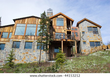 Beautiful log home built high up in the mountains - stock photo
