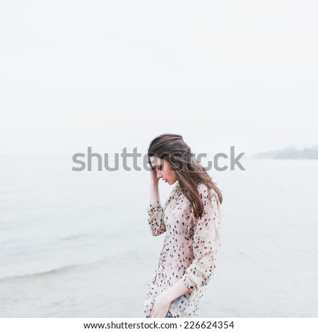 beautiful lonely young hipster girl on the beach - stock photo