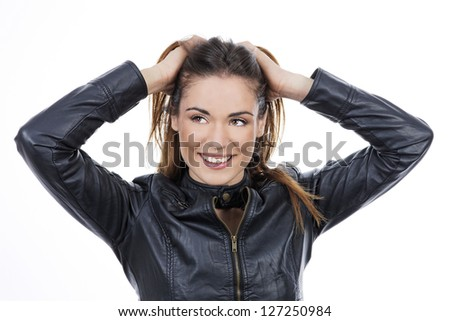 beautiful long brown hair woman with hand in hair - stock photo