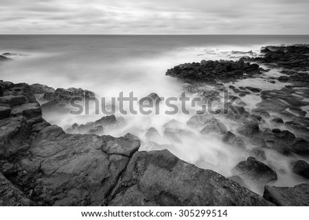 Beautiful long exposure landscape of rocky sea shore.  - stock photo