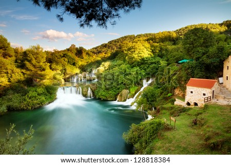 Beautiful long exposure panorama over some waterfalls of the Krka river in Krka national park in Croatia - stock photo