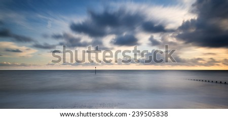 Beautiful long exposure vibrant conceptual image of ocean at sunset - stock photo