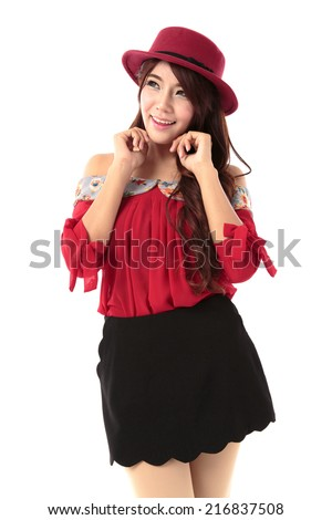 Beautiful long hair asian woman posing in camisole bow red top and black pleated skorts with red hat isolated on white background.
