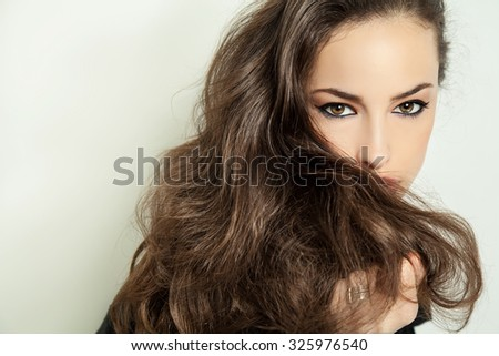 beautiful long hair brunette portrait, studio white