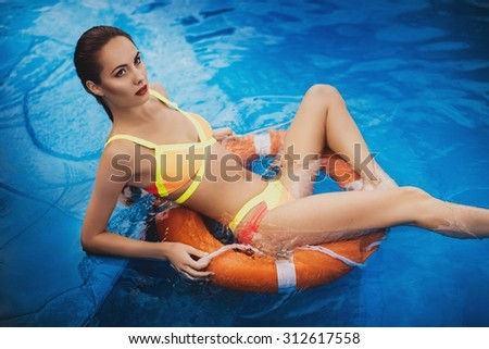 beautiful long hair female model posing by the pool, outdoor portrait