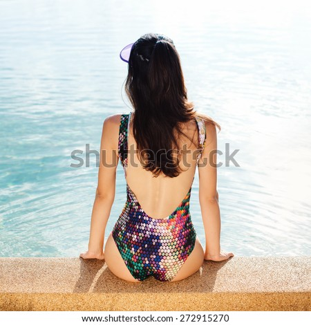 beautiful long hair female model posing by the pool. Outdoors lifestyle portrait - stock photo