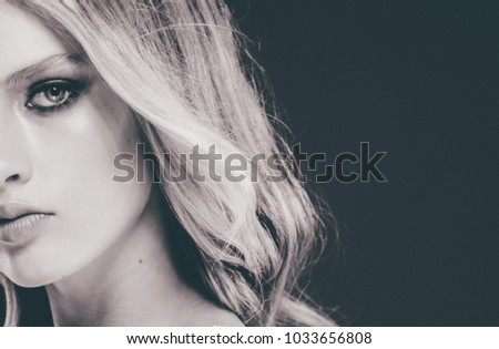 Beautiful long hair young girl black and white with blonde hairstyle over black background