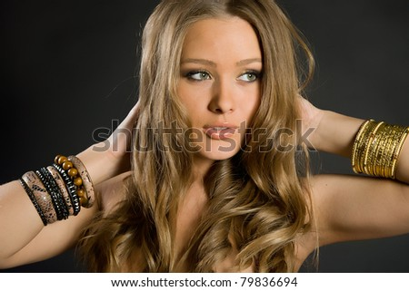 beautiful long-haired girl on a black background - stock photo