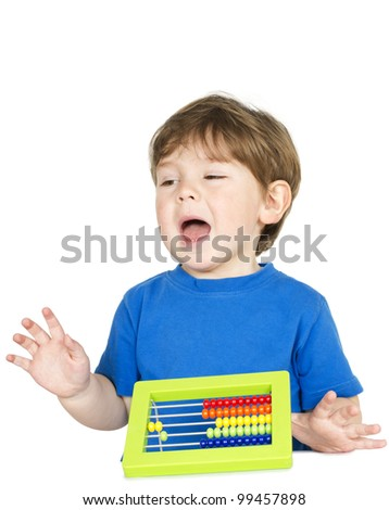 Beautiful, loud kid at the table with an abacus - isolated over a white background. - stock photo