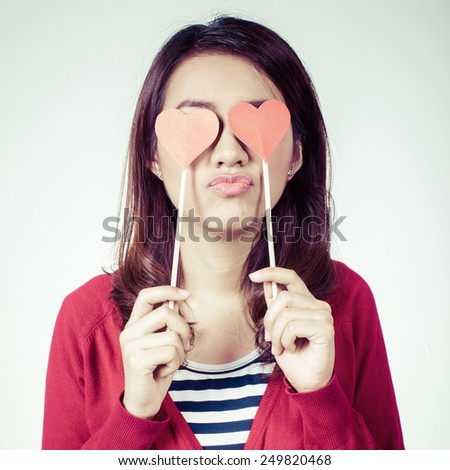 beautiful love a girl with hearts in the hands sends a kiss, a girl with hearts for eyes, process color - stock photo