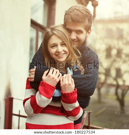 Beautiful loving couple are hugging - stock photo