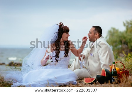 Beautiful loving couple bride and groom enjoying their wedding day outdoors in the park.