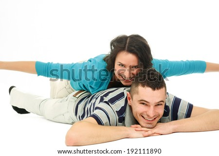 Beautiful loving couple lying on the floor - isolated - stock photo