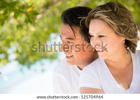 Beautiful loving couple on holidays at the beach