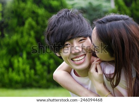 Beautiful loving couple smiling - stock photo
