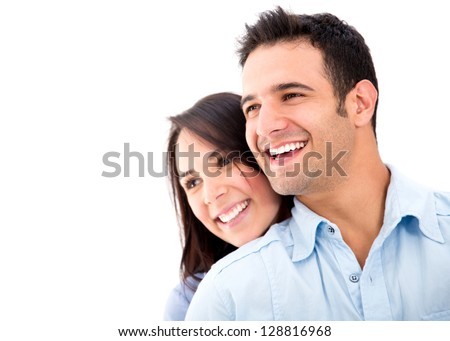 Beautiful loving couple smiling - isolated over a white background