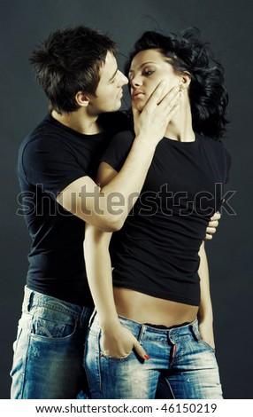 Beautiful loving couple studio shoot - stock photo