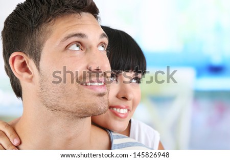 Beautiful loving couple together on bright background
