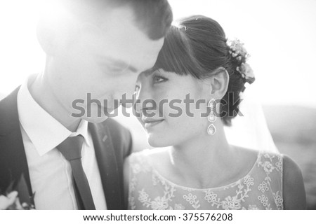 Beautiful loving couple walking and kissing wedding day sitting
