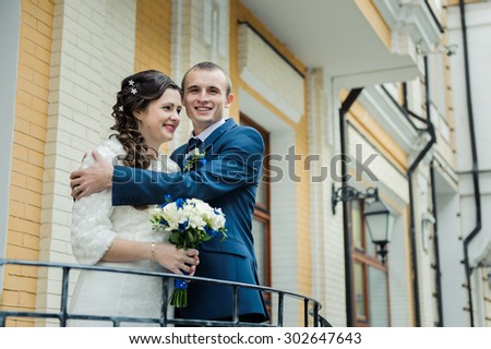 beautiful loving just married couple staying close and hugging