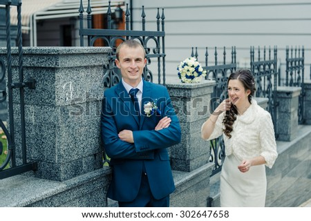 beautiful loving just married couple walking on the street