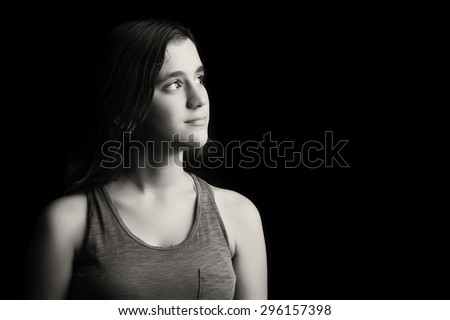 Beautiful low key black and white portrait of a teenage girl - stock photo