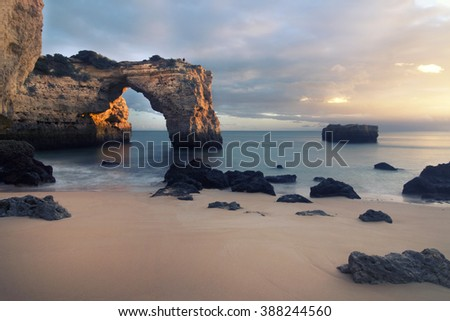 Beautiful low tide view of the Albandeira beach located in the Algarve region, Portugal. - stock photo