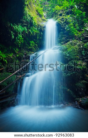 Beautiful Lush Waterfall in Hawaii - stock photo