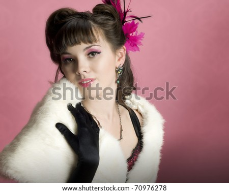 Beautiful Luxurious Model wearing Dramatic Makeup and Pinup Styled Hair - stock photo
