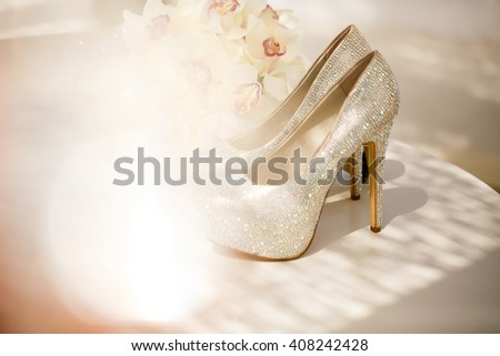 Beautiful luxury bouquet and heels for bride - stock photo