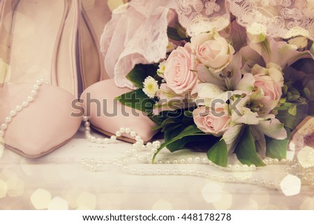 Beautiful luxury bouquet and heels for bride. - stock photo