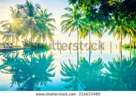 Beautiful luxury hotel pool resort neary beach - Vintage filter effect processing - stock photo