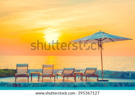Beautiful luxury hotel swimming pool resort with umbrella and chair - Vintage filter