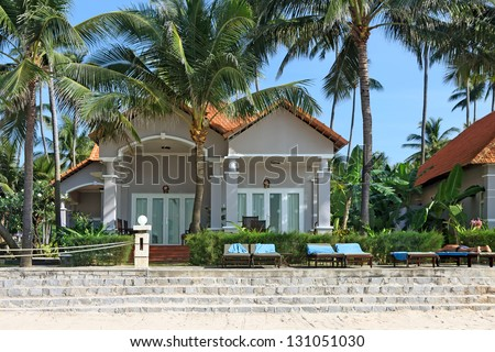 Beautiful luxury houses in tropical resort on the beach - stock photo