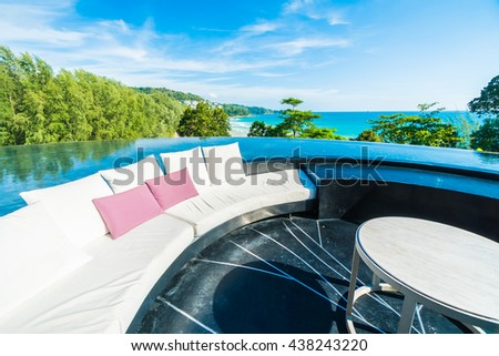 Beautiful luxury outdoor patio decoration with sofa and pillow on sea and ocean with blue sky background