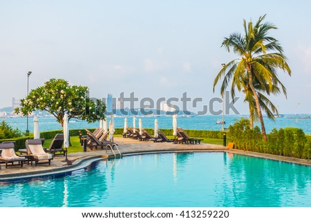 Beautiful luxury outdoor swimming pool in hotel resort - Boost up color Processing