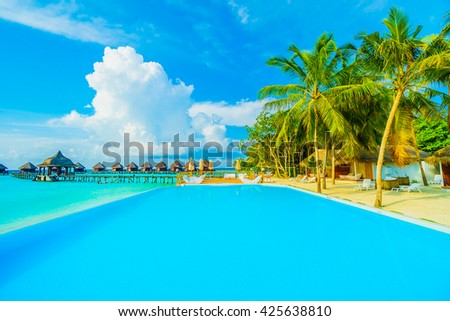 Beautiful luxury outdoor swimming pool with umbrella and chair in hotel resort at maldives - Boost up color and Filter effect Processing