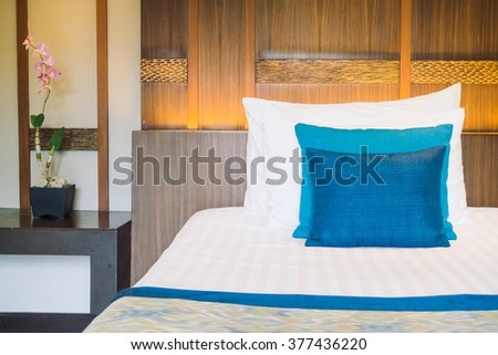 Wooden store shelf color clothes stock photo 27365596 for Beautiful bed decoration