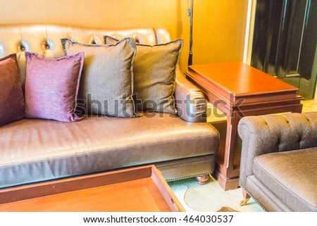 Beautiful luxury pillow on leather sofa decoration in living room interior