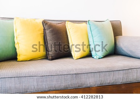 Beautiful luxury pillow on sofa chair decoration with table light lamp in living area room interior - Vintage light Filter
