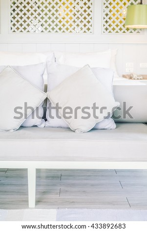 Beautiful luxury pillow on sofa decoration in bedroom interior - Vintage light Filter