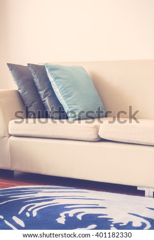 Beautiful luxury pillow on sofa decoration in living room interior - Vintage Light Filter