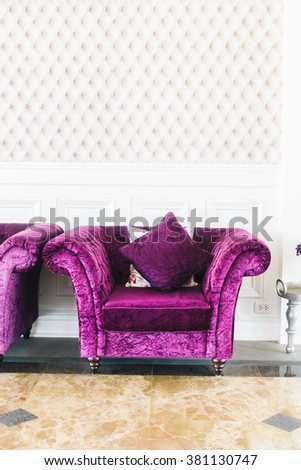 Beautiful luxury purple sofa with pillow decoration in livingroom interior  - Vintage Film Filter