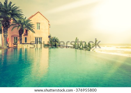 Beautiful luxury Swimming pool resort hotel with stairs pool - Vintage Filter and sunflare effect processing - stock photo