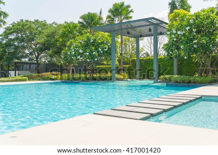 Beautiful luxury swimming pool with palm tree - Boost up color Processing