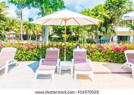 Beautiful luxury umbrella and chair around outdoor swimming pool in hotel resort - Holiday Vacation concept for background